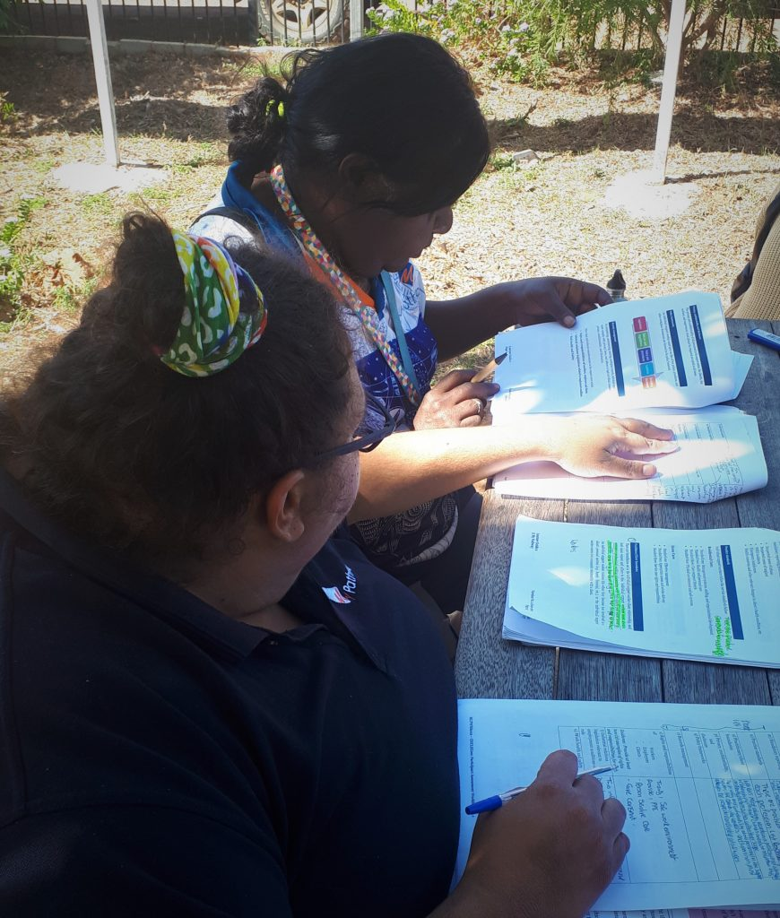 My Pathway mentor Leah Garling assists support worker Gaylene at an outdoor table